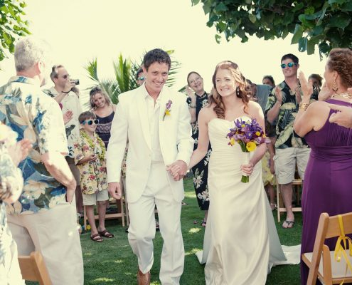 Bride and groom at their intimate wedding ceremony in Hawaii planned by Destination wedding planner, Mango Muse Events