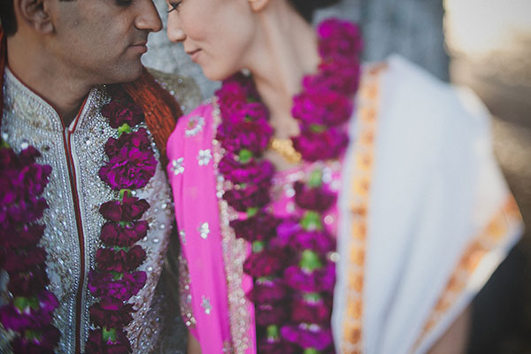 Bride and groom in traditional Indian ceremony clothing at their multi-cultural wedding by Destination wedding planner, Mango Muse Events