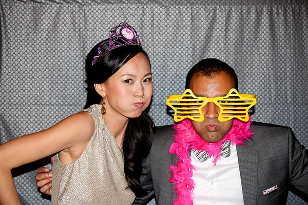 Bride and groom making faces and having fun in their wedding photobooth planned by destination wedding planner, Mango Muse Events