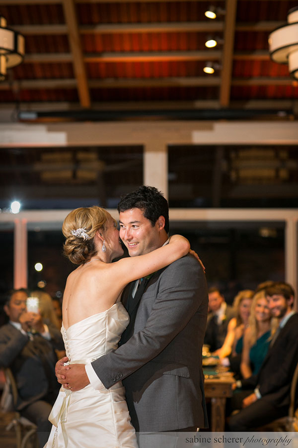 Bride and groom dancing their first dance at a Carmel destination wedding planned by Destination wedding planner, Mango Muse Events