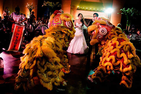 Chinese lion dance to bring good luck to the newlyweds at this Sonoma destination wedding planned by Destination wedding planner, Mango Muse Events