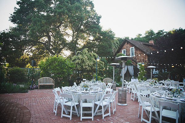 Wedding reception setup outside at the Los Altos History Museum created by Destination wedding planner, Mango Muse Events