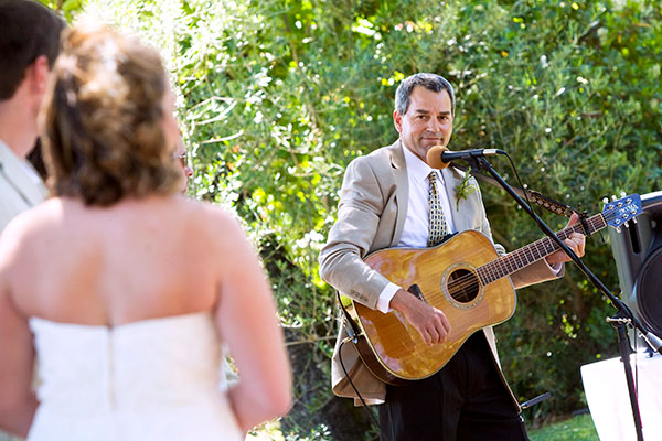 Father of the bride singing a song for the bride and groom at a wedding ceremony in Healdsburg by Destination wedding planner, Mango Muse Events