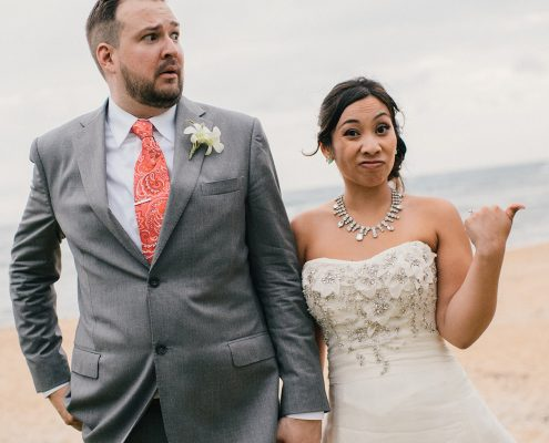Bride and groom making funny faces at their Hawaii destination wedding by Destination wedding planner, Mango Muse Events