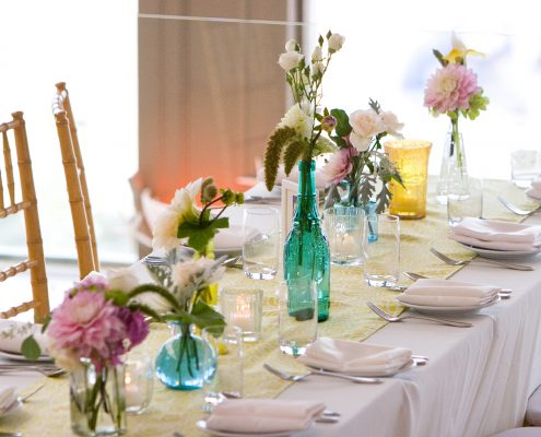 Vintage collected vases used for wedding decor for a Half Moon Bay wedding by Destination Wedding Planner Mango Muse Events