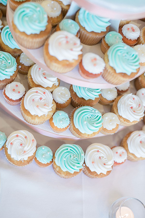 Aqua and peach colored cupcakes for a wedding dessert table for a Hawaii destination wedding by Destination wedding planner, Mango Muse Events