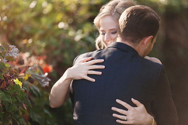 Bride and groom hugging after seeing each other for the first time on their wedding day at their Sonoma destination wedding by Destination wedding planner, Mango Muse Events