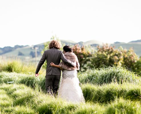 Bride and groom walking arm in arm at their Sonoma destination wedding by Destination wedding planner, Mango Muse Events