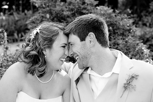 A bride a groom smiling ear to ear at their wine country wedding in Healdsburg by Destination wedding planner, Mango Muse Events
