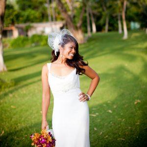 A destination bride striking a pose at her Maui destination wedding