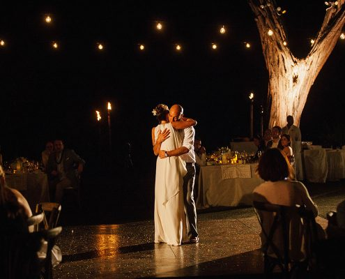 First dance under string lights at a Big Island Hawaii destination wedding by Destination wedding planner Mango Muse Events