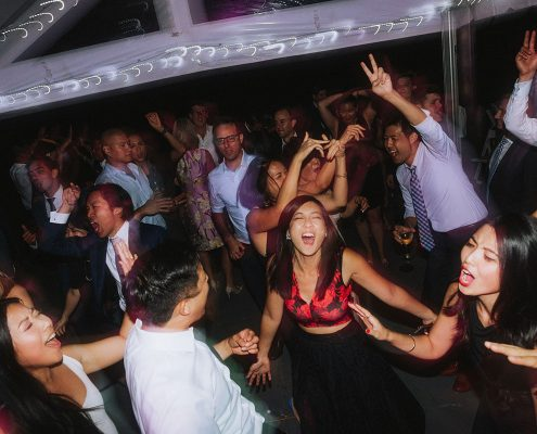 Guests singing and dancing at a Vancouver destination wedding by Destination wedding planner Mango Muse Events