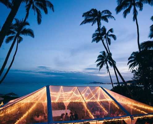 Night time wedding tent with lights at a Hawaii wedding by Destination wedding planner Mango Muse Events