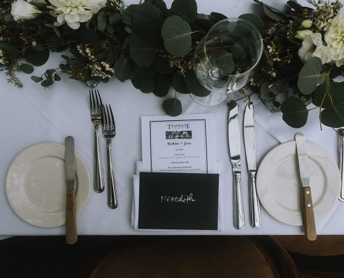 Table setting and hand written letter placecard at a Vancouver destination wedding by Destination wedding planner Mango Muse Events