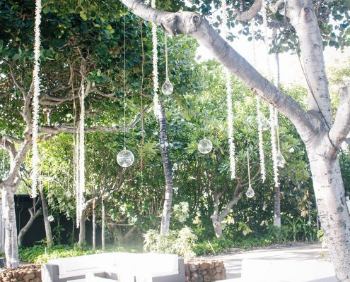 Hanging florals above the lounge at a Big Island Hawaii destination wedding by Destination wedding planner Mango Muse Events
