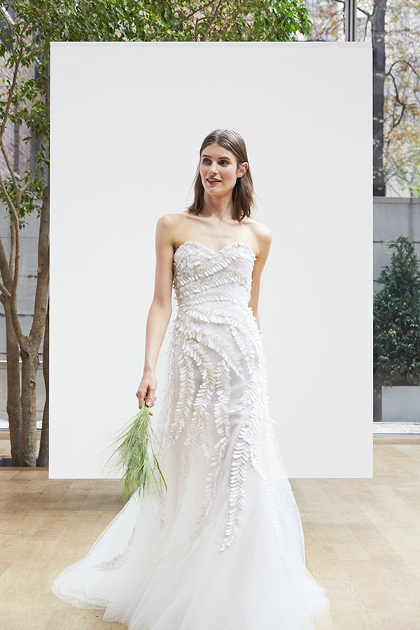 A tulle leaf pattern wedding dress by Oscar de la Renta from Bridal Fashion Week Spring 2018 Collections shared by Destination wedding planner, Mango Muse Events