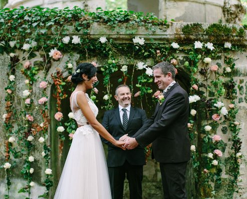 Outdoor wedding ceremony in the forest of a France Chateau wedding by Destination wedding planner Mango Muse Events