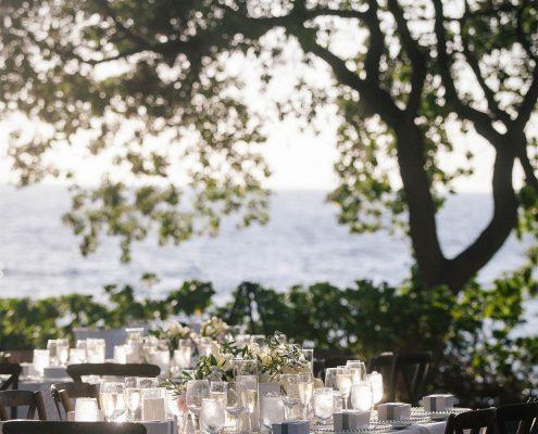 Outdoor wedding reception oceanside at the Mauna Kea Resort at a Big Island Hawaii destination wedding by Destination wedding planner Mango Muse Events