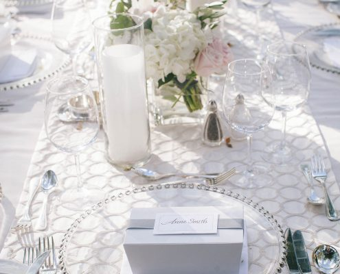 Elegant white wedding tablescape at a Big Island Hawaii destination wedding by Destination wedding planner Mango Muse Events