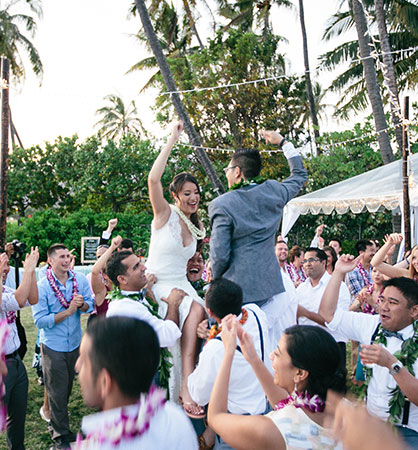 First dance with wedding guests at a Hawaii destination wedding by Destination wedding planner, Mango Muse Events