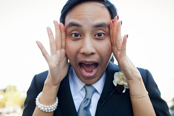 Groom making funny faces at a San Francisco wedding by destination wedding planner Mango Muse Events