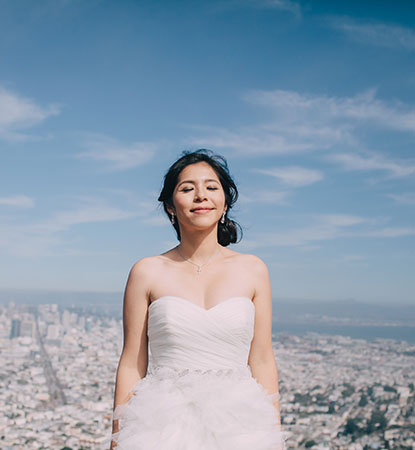 A relaxed bride at enjoying the view at a San Francisco destination wedding by Destination wedding planner Mango Muse Events