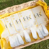 Ceremony fans with monograms for a Hawaii destination wedding
