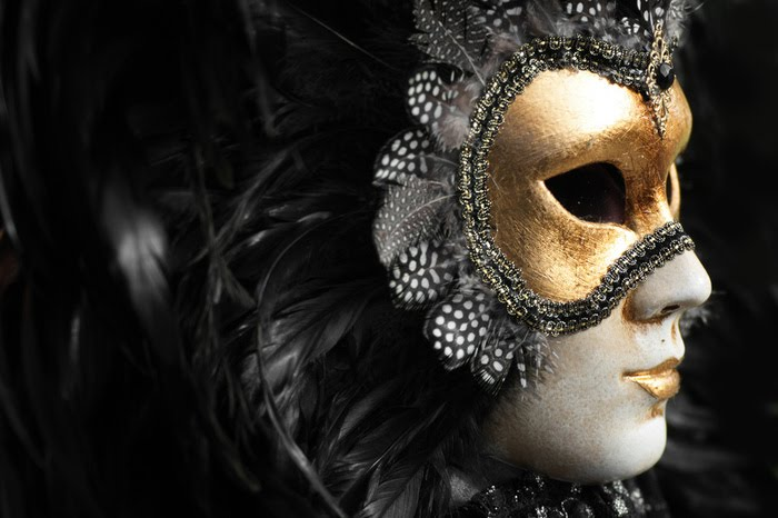 Gold and black Venetian mask as Mardi Gras wedding inspiration by Destination wedding planner, Mango Muse Events