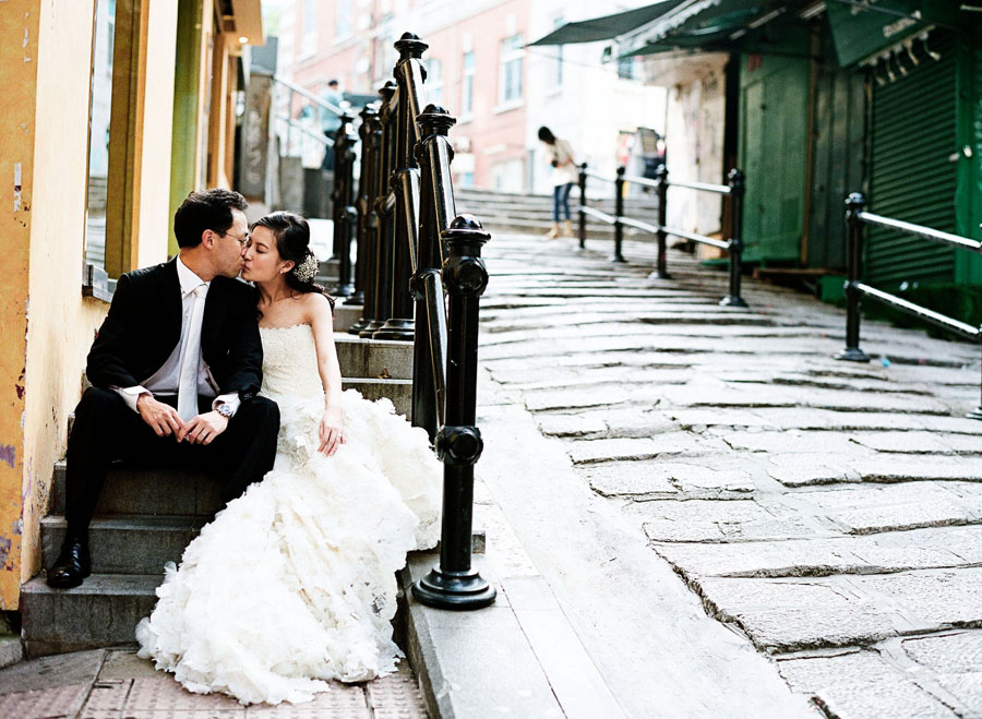 Wedding couple in Hong Kong streets for a Hong Kong destination wedding by Destination wedding planner, Mango Muse Events