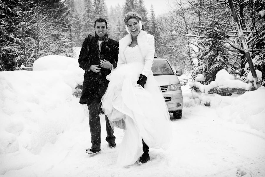 Wedding couple in the snow at an Austria destination wedding shared by Destination wedding planner, Mango Muse Events