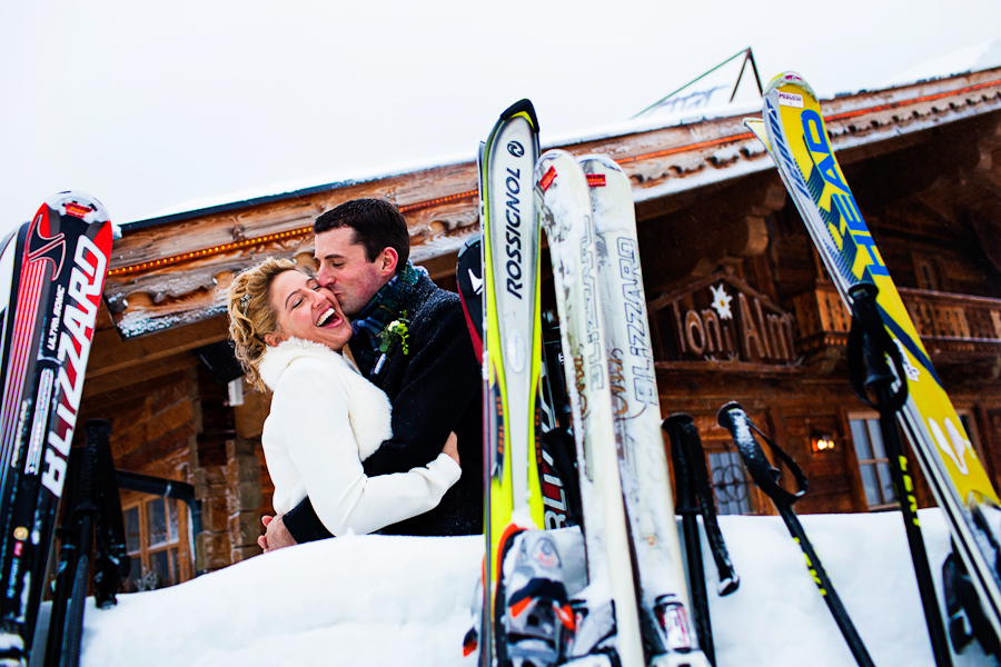 Winter wedding with skis at an  Austria destination wedding shared by Destination wedding planner, Mango Muse Events