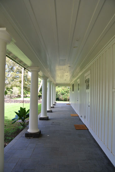 White columns line the walkway of the lodge of Dillingham Ranch a Hawaii wedding venue for a Hawaii destination wedding by Destination wedding planner Mango Muse Events