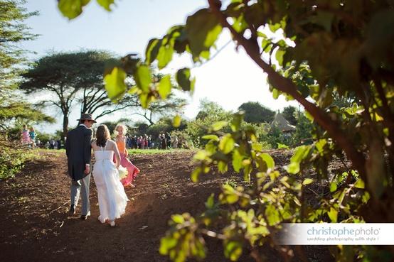 Wedding couple walking to their wedding celebration at a Kenya destination wedding shared by Destination wedding planner, Mango Muse Events