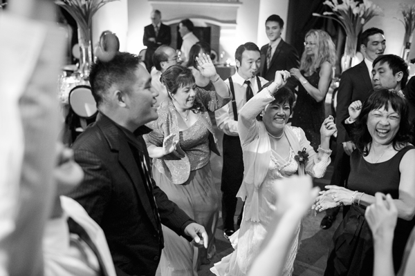 Guests dancing at a wedding reception at a Sonoma destination wedding by Destination wedding planner Mango Muse Events