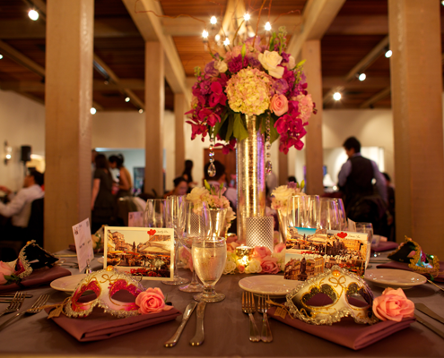 Venetian masks as wedding favors at a Italian inspired vineyard wedding by Destination wedding planner Mango Muse Events