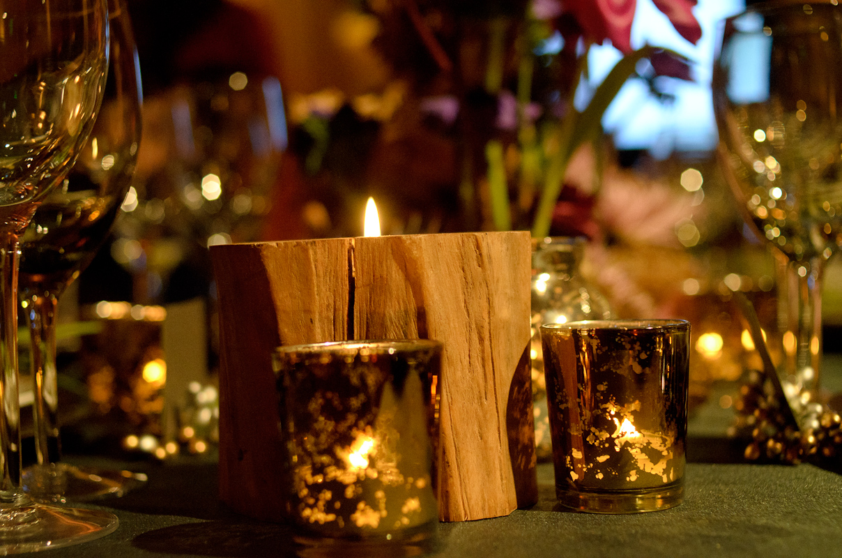 Candles on a wedding reception table designed by Destination wedding planner, Mango Muse Events