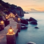 Lighted pathway by the ocean shared by Destination wedding planner Mango Muse Events
