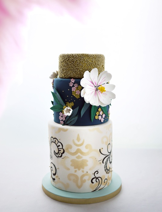 Navy gold and white floral and printed wedding cake designs by Charm City Cakes and shared by Destination wedding planner Mango Muse Events