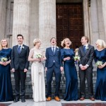 A photo of a wedding party laughing an example of great wedding photography shared by Destination wedding planner Mango Muse Events