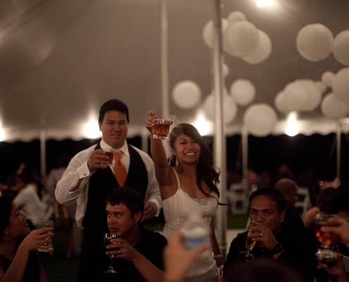 Wedding couple toasting at a Hawaii destination wedding