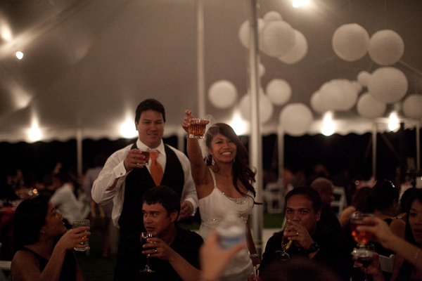 Wedding couple toasting at a Hawaii destination wedding and not doing a champagne toast