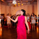 Bride with a wedding dress change doing the bouquet toss at a San Francisco wedding reception by Destination wedding planner Mango Muse Events