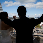 Wedding couple shouting excitement from the rooftops at a San Francisco Wedding by Destination Wedding Planner Mango Muse Events