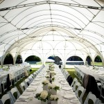 Architectural white wedding tent and all white wedding design shared by Destination wedding planner Mango Muse Events