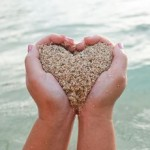 Heart of sand held in two hands