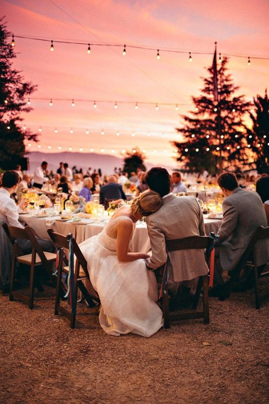 Great wedding photography of a wedding couple leaning on each other and enjoying a sunset at their wedding reception shared by Destination wedding planner Mango Muse Events