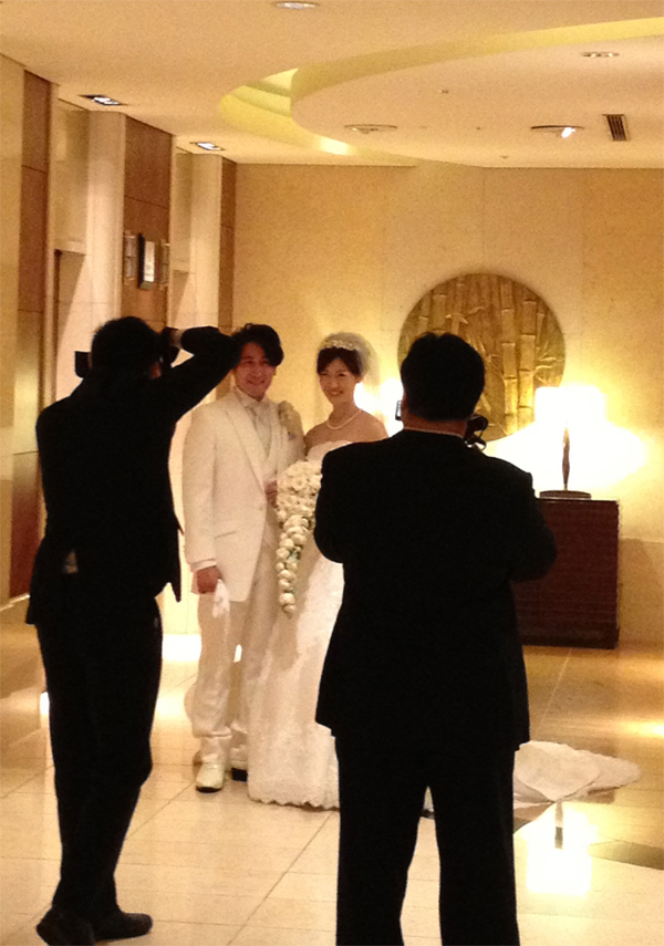 Bride and groom dressed in all white at a hotel Japanese wedding shared by Destination wedding planner Mango Muse Events
