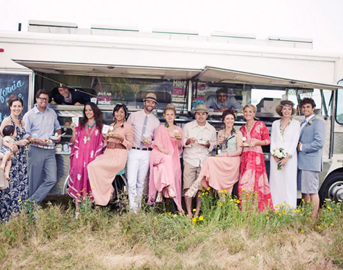 Wedding Guests in front of a food truck at a food truck wedding