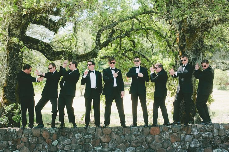Wedding party photos with the groomsmen in James Bond poses