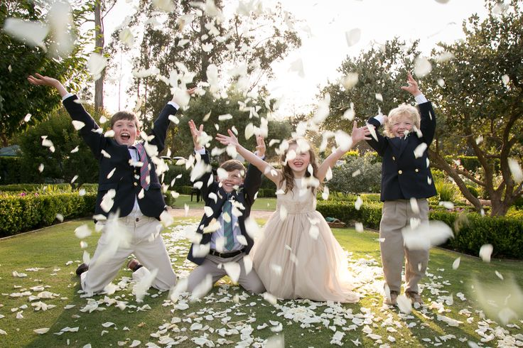 Kids throwing flower petals at a wedding